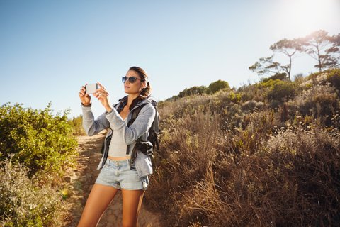 hiking girl with phone