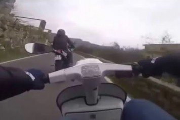 Watch a Vespa Scooter Own This Motorcyclist