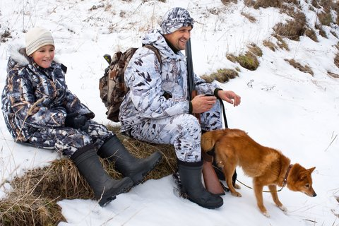 father son hunting with dog