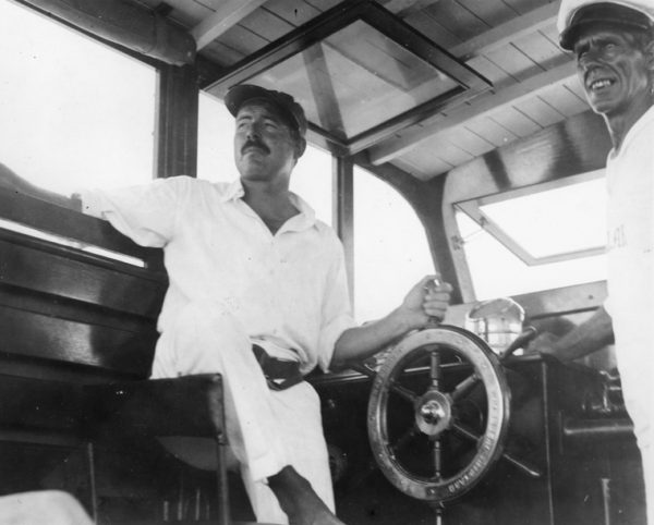 EH 8300P Ernest Hemingway and Carlos Gutierrez aboard Hemingway's boat, the Pilar, 1934. Photograph in the Ernest Hemingway Photograph Collection, John F. Kennedy Presidential Library and Museum, Boston.