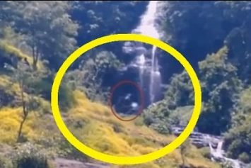 Video Purports to Show Bigfoot Bathing Under Waterfall